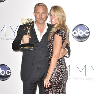 Kevin Costner, Christine Baumgartner in 64th Annual Primetime Emmy Awards - Press Room