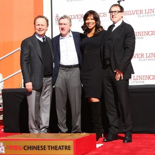 Billy Crystal, Robert De Niro, Grace Hightower, David O. Russell in Robert De Niro Places His Hand and Foot Prints in Cement During The Footprint Ceremony