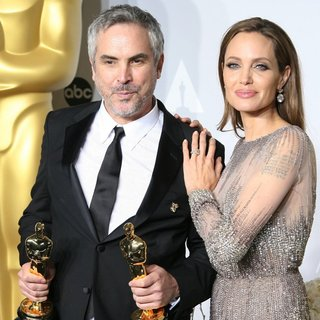 Alfonso Cuaron, Angelina Jolie in The 86th Annual Oscars - Press Room