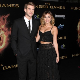 Liam Hemsworth, Miley Cyrus in Los Angeles Premiere of The Hunger Games - Arrivals