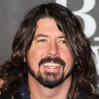 Dave Grohl, Foo Fighters in The 2013 Brit Awards - Arrivals