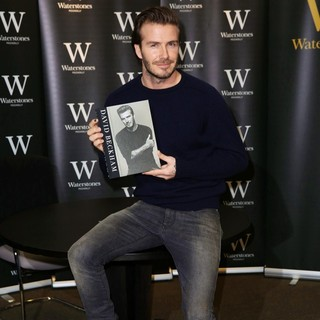 David Beckham Signs Copies of His Book Entitled David Beckham
