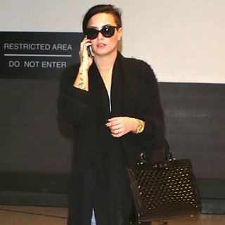 Demi Lovato Arrives at Los Angeles International Airport