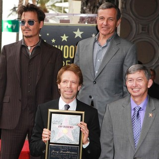 Johnny Depp, Jerry Bruckheimer, Bob Iger, Leron Gubler in Jerry Bruckheimer Honored on The Hollywood Walk of Fame