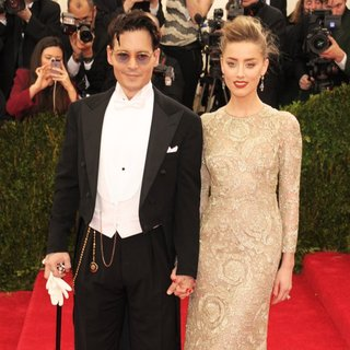 Johnny Depp, Amber Heard in Charles James: Beyond Fashion Costume Institute Gala - Arrivals