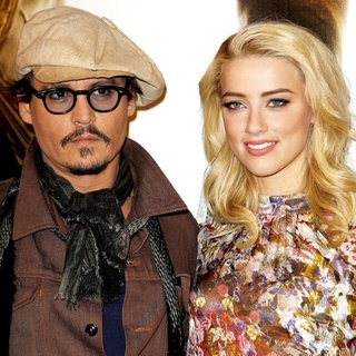 Johnny Depp, Amber Heard in The Rum Diary Photocall