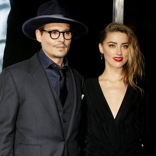 Johnny Depp, Amber Heard in 3 Days to Kill Premiere - Red Carpet Arrivals