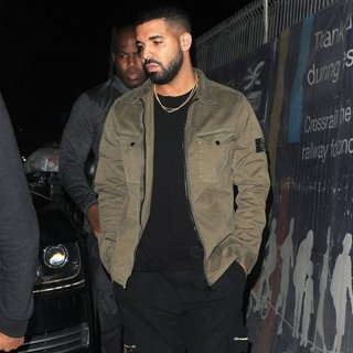 Drake Seen Leaving Tape Club