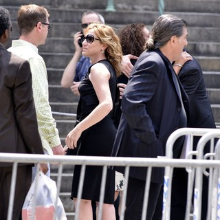 Edie Falco in The Funeral Service for Actor James Gandolfini