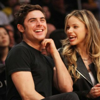 Zac Efron, Halston Sage in Celebs at The Lakers Game