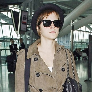 Emma Watson in Emma Watson Wearing A Hat and Sunglasses as She Arrives at Heathrow Airport