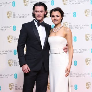 Luke Evans, Samantha Barks in EE British Academy Film Awards 2014 - Press Room