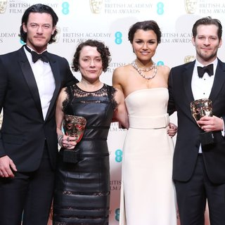 Luke Evans, Sophie Venner, Samantha Barks, James W. Griffiths in EE British Academy Film Awards 2014 - Press Room
