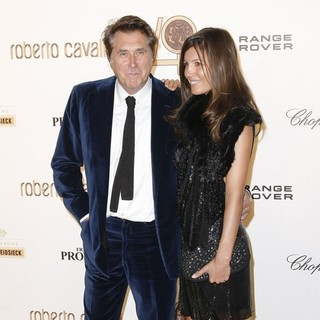 Bryan Ferry, Amanda Sheppard in Paris Fashion Week - Roberto Cavalli 40th Aniversary Party - Arrivals