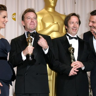 Tina Fey, Philip Stockton, Eugene Gearty, Bradley Cooper in 84th Annual Academy Awards - Press Room