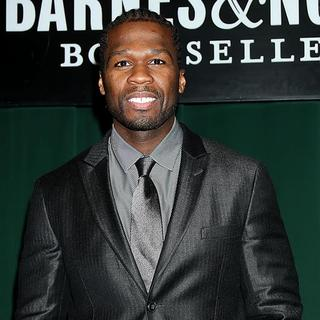 50 Cent in 50 Cent Signs Copies of His New Book Playground