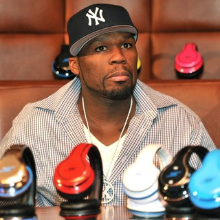 50 Cent in 50 Cent Signs Copies of his SMS Audio Designed Headphones