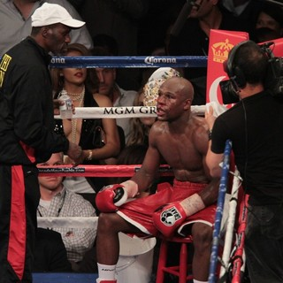 Floyd Mayweather, Jr. in The Fight Floyd Mayweather, Jr. Defeated Miguel Cotto by Way of A Twelve Round Unanimous Decision