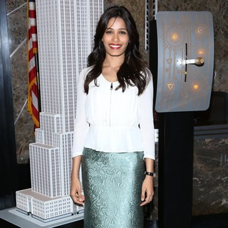 Freida Pinto in Freida Pinto Illumintes The Empire State Building