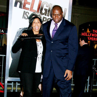 Magic Johnson, Cookie Johnson in Los Angeles Premiere of 'The Book Of Eli' - Arrivals