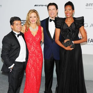 Oscar Generale, Kelly Preston, John Travolta, Denny Mendez in amfAR 21st Annual Cinema Against AIDS During The 67th Cannes Film Festival