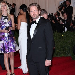Gerard Butler in Schiaparelli and Prada Impossible Conversations Costume Institute Gala