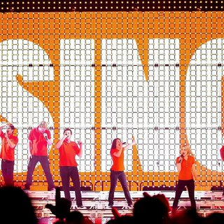 Kevin McHale, Chris Colfer, Harry Shum Jr., Chord Overstreet, Cory Monteith, Lea Michele, Dianna Agron, Amber Riley, Jenna Ushkowitz, Naya Rivera in The Cast of Glee Live in Concert Performing on Stage