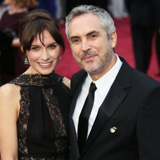 Sheherazade Goldsmith, Alfonso Cuaron in The 86th Annual Oscars - Red Carpet Arrivals