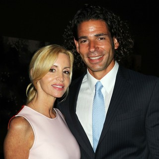Camille Grammer, Dimitri Charalambopoulos in GBK Productions Luxury Lounge During Emmy's Weekend