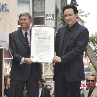 Leron Gubler, John Cusack in John Cusack Honored with A Star on The Hollywood Walk of Fame