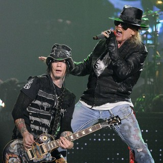 DJ Ashba, Axl Rose, Guns N' Roses in Guns N' Roses Perform on Stage at Copps Coliseum in Hamilton