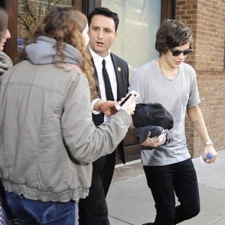 Harry Styles, One Direction in Harry Styles Carrying A Toiletry Bag, Is Seen Leaving The Hotel That He and Taylor Swift Arrived