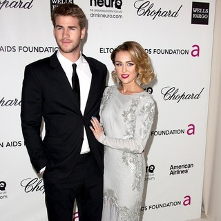 Liam Hemsworth, Miley Cyrus in The 20th Annual Elton John AIDS Foundation's Oscar Viewing Party - Arrivals