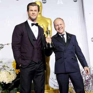 Chris Hemsworth, Glenn Freemantle in The 86th Annual Oscars - Press Room