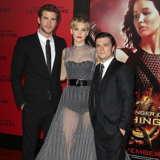Liam Hemsworth, Jennifer Lawrence, Josh Hutcherson in The Hunger Games: Catching Fire Premiere