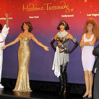 Whitney Houston, Gary Garland in Madame Tussauds Unveils Four Wax Figures of Whitney Houston