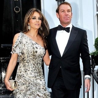 Elizabeth Hurley, Shane Warne in Elizabeth Hurley and Shane Warne Making Their Way to Elton John's Party