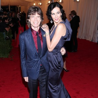 Mick Jagger, L'Wren Scott in Schiaparelli and Prada Impossible Conversations Costume Institute Gala