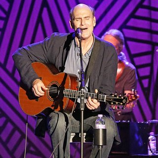 James Taylor in James Taylor Performing Live on Stage