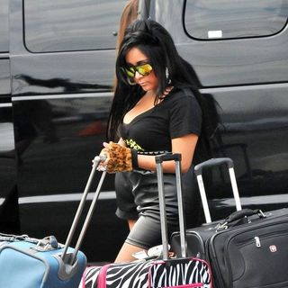 Snooki in The Cast of Jersey Shore Returns to Seaside Heights After Filming in Florence, Italy