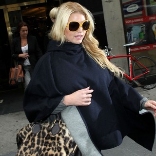 Jessica Simpson in Jessica Simpson All Covered Up as She Leaves Bergdorf Goodman with Her Sister