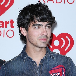 Joe Jonas, Jonas Brothers in 2012 iHeartRadio Music Festival - Day 2 - Arrivals