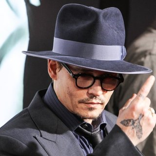 Johnny Depp in 3 Days to Kill Premiere - Red Carpet Arrivals
