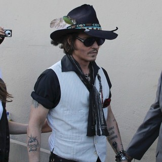Johnny Depp Sign Autographs Outside The El Capitan Theatre - johnny-depp-sign-autographs-01