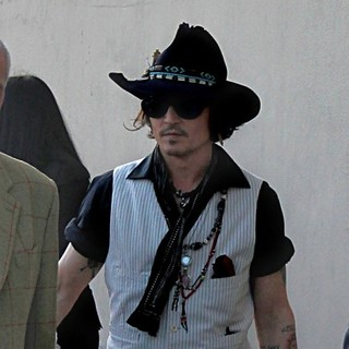 Johnny Depp in Johnny Depp Sign Autographs Outside The El Capitan Theatre