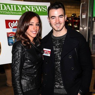 Danielle Deleasa, Kevin Jonas in Kevin Jonas and Danielle Deleasa Host A FDNY Food Drive for Hurricane Sandy Victims