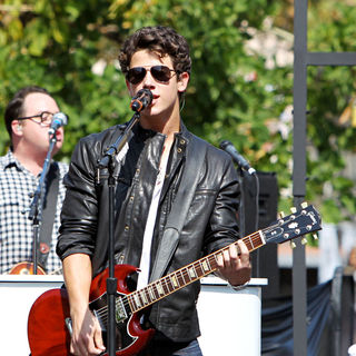 Nick Jonas, Jonas Brothers in Jonas Brothers performing live on stage at The Grove