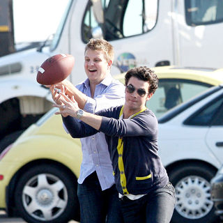 Jonas Brothers - Jonas Brothers playing American football between scenes on the set 'Chasing Butterflies'