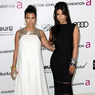 Kourtney Kardashian, Kim Kardashian in The 20th Annual Elton John AIDS Foundation's Oscar Viewing Party - Arrivals