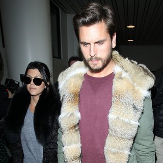Kourtney Kardashian, Scott Disick in Kourtney Kardashian and Scott Disick Arrive at Los Angeles International Airport